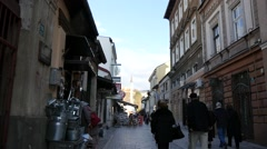 Street scene with people walking through the old part of Sarajevo. Stock Footage