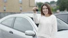 Portrait of happy woman with new car Stock Footage