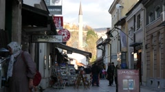 Urban street scene in old part of Sarajevo city with view on mosque. Stock Footage