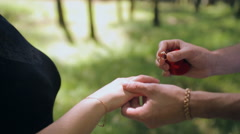 marriage proposal with wedding rings - stock footage