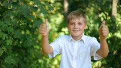 Teen boy shows gesture cool!  Arkistovideo