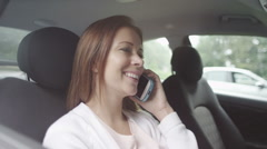 Attractive young girl laughs and smiles on the phone Stock Footage