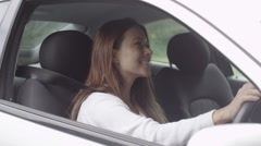 Portrait of attractive young girl admiring her new car Stock Footage