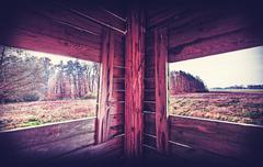 Vintage filtered interior of hunting tower in autumn season. Stock Photos