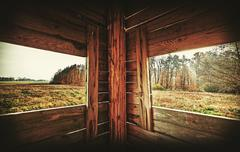 Retro filtered interior of hunting tower in autumn season. Stock Photos