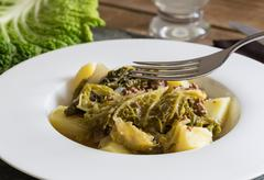 Savoy cabbage stew with potatoes and minced Stock Photos
