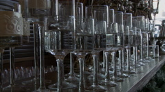 Several large glass vases filled with water Stock Footage