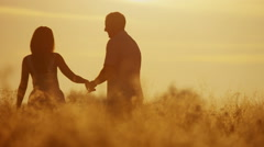 Stock Video Footage of Casual Dressed Caucasian Couple Outdoors Together Sunset Loving Relationship
