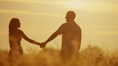 Stock Video Footage of Attractive Happy Young Caucasian Male Female Couple Love Together Sunset
