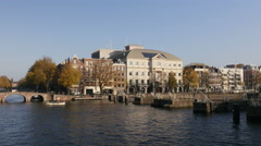 Carre theatre in Amsterdam with canal Stock Footage