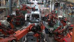 Robots weld car parts in production line at factory. Car factory Stock Footage