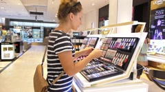 Young Pretty Female Chooses Mascara at Cosmetics Shop. - stock footage