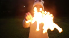 Teenager girl Holding sparkler - stock footage