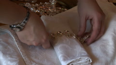 Decorator adorns napkin for wedding table Stock Footage