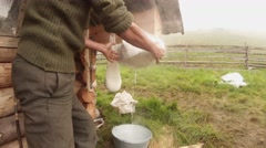 large piece of cheese hanging in cheesecloth for dehydration mountain tradition - stock footage