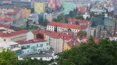 Colorful buildings of European city, Gothic church city traffic, click for HD - stock footage