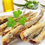 Spanish boquerones fritos, battered and fried anchovies typical in spain Stock Photos
