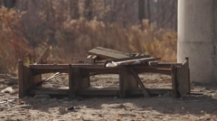 Old broken theatrical seats under bridge medium shot - stock footage