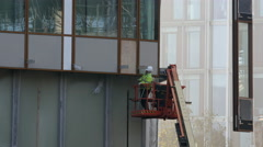Construction worker in crane caddy - stock footage