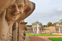 Closeup naked satyr smiling statue crop with fountain and garden Stock Photos