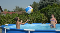 Children playingin the pool Stock Footage