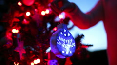 Handheld shot of girl holding Christmas decoration Stock Footage