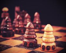 Vintage filtered picture of chess, one against all concept. Stock Photos