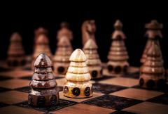 Picture of a chess, one against all concept. Stock Photos