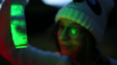 Handheld shot of girl holding Christmas decoration - stock footage