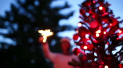 Handheld shot of teenager girl Holding sparkler - stock footage