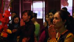 Asian Women Praying at the Temple of Literature in Hanoi, Vietnam Stock Footage