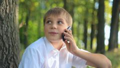 Child teen boy talking on mobile phone Stock Footage