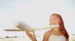 Stock Video Footage of Happy Caucasian Girl Simple Toy Play Airplane Future Dreams Aspirations Outdoors