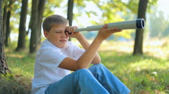 Kid looking through a telescope Stock Footage