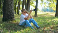 Child teen boy looking through a telescope  Stock Footage