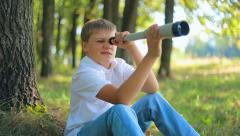 Child teen boy looking through a telescope 002 Stock Footage