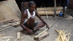 Indian man is processing bamboo Stock Footage