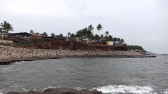 Pan across entrance to the Anjuna Beach from sea Stock Footage