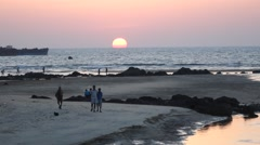 People walking on the Shiroda beach during sunset Stock Footage