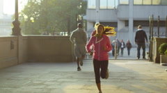 Runners working out in the city on a sunny autumn day Stock Footage