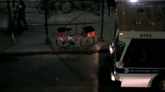 MTA bus at night in NYC pulling up to busstop in New York City - stock footage
