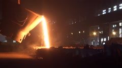Iron and Steel Works. Pouring of molten iron. - stock footage