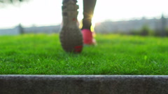 Low angle view of the feet of a female athlete walking through natural environme Stock Footage
