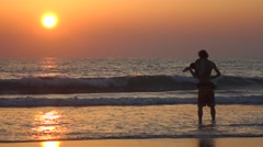 Man is playing violin at the Arambol beach Stock Footage
