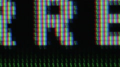 Closeup of LCD TV displaying bits of text Stock Footage