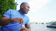 Male runner in the city takes a break to drink some water Stock Footage