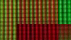 Macro shot of bright squares on screen Stock Footage
