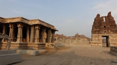 Pan to the stone chariot in Vittala Temple Stock Footage
