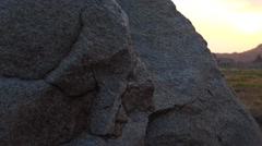 Pan from behind the rock to the Vittala Temple during sunset Stock Footage