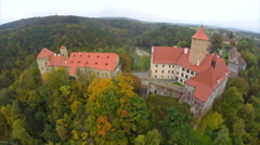 Beautiful fly aerial shot Czech Republic castle red roofs autumn, click for HD Stock Footage